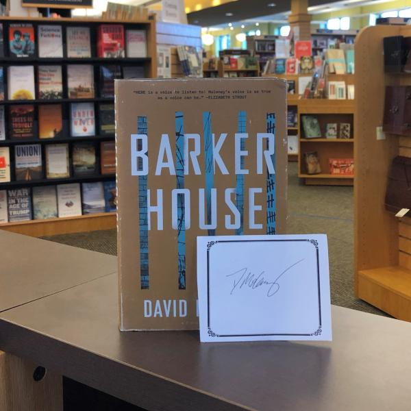 A hardcover copy of Barker House by David Moloney is posed with a signed bookplate