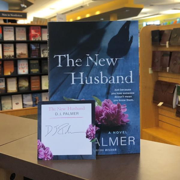 A hardcover copy of The New Husband by Daniel Palmer is posed with a signed bookplate, which is themed with The New Husband cover motifs