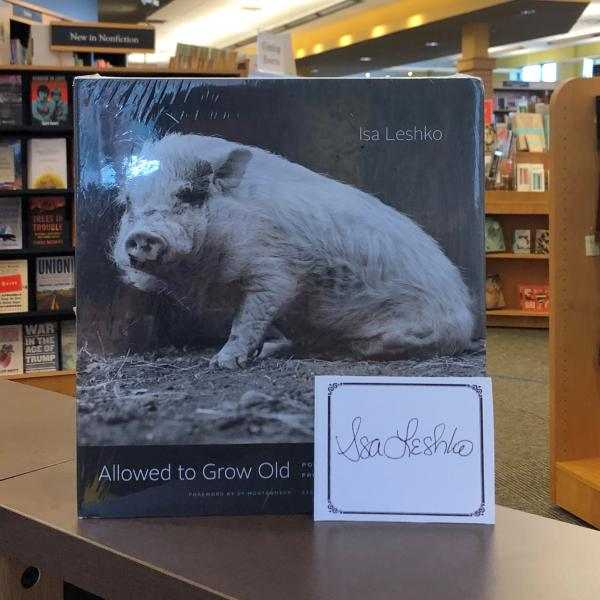 A hardcover copy of Allowed to Grow Old: Portraits of Elderly Animals from Farm Sanctuaries by Isa Leshko is posed with a signed bookplate