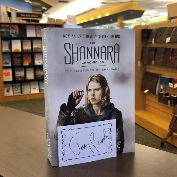 A copy of The Shannara Chronicles by Terry Brooks is posed with a signed bookplate